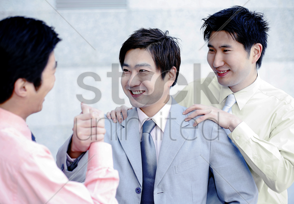businessmen greeting each other stock photo