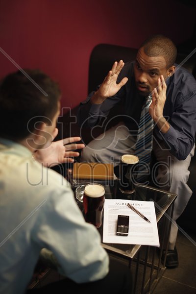 businessmen having discussion over drinks stock photo