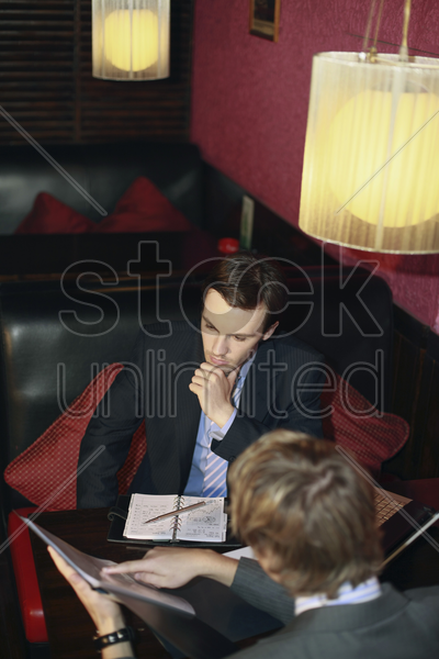 businessmen having discussion stock photo