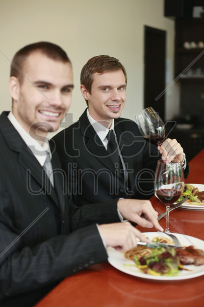 businessmen having lunch at a restaurant stock photo
