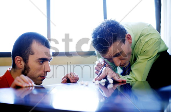 businessmen playing self-made pool stock photo