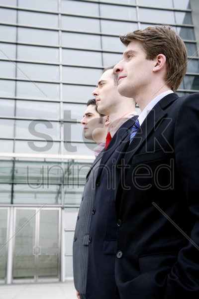 businessmen standing straight in a row stock photo