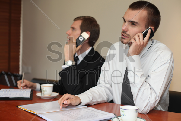 businessmen talking on the phone stock photo