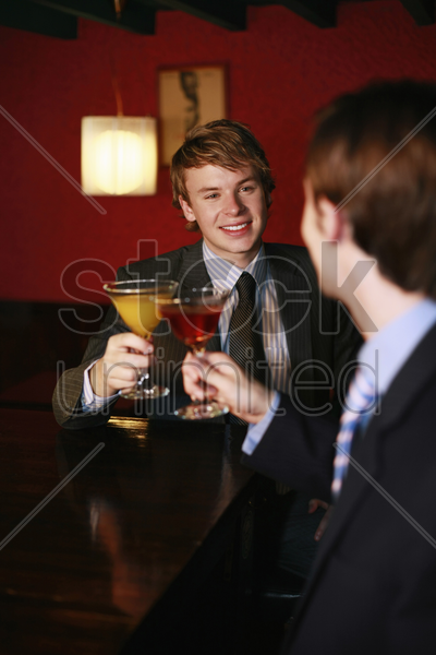 businessmen toasting cocktails stock photo