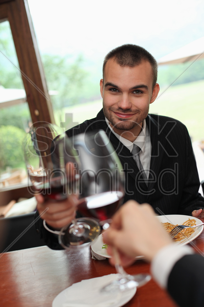 businessmen toasting wine stock photo