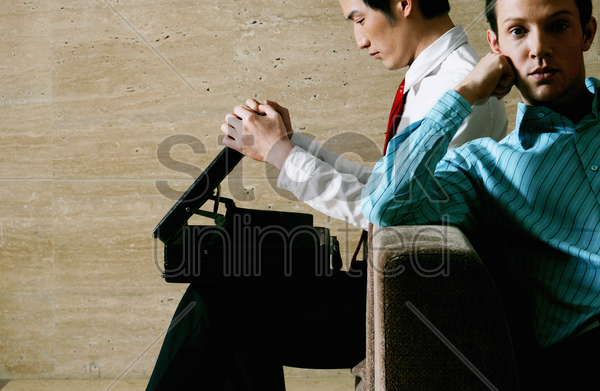 businessmen waiting to be interviewed stock photo