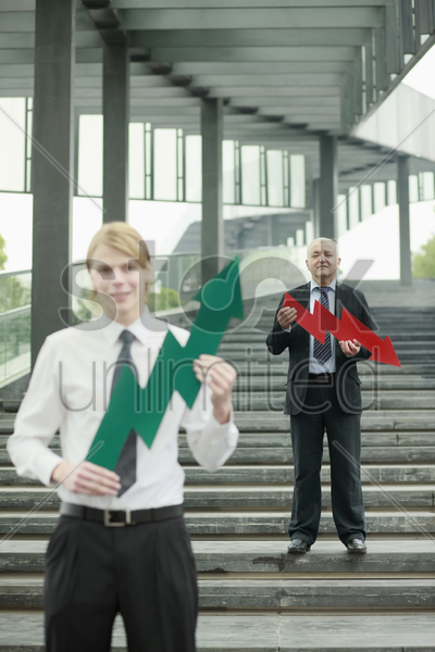 businessmen with arrow signs stock photo