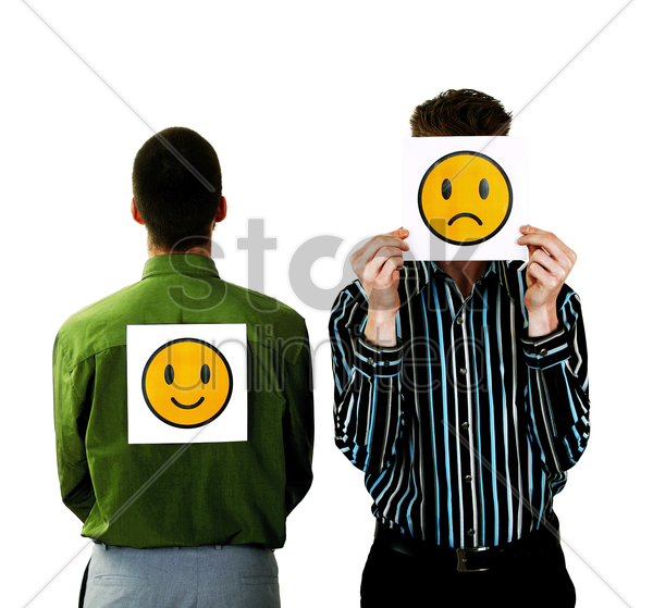 businessmen with happy and sad icons stock photo