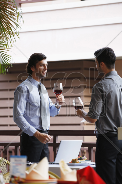 businessmen with wineglasses stock photo