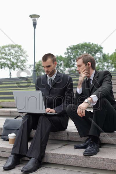 businessmen working outdoors stock photo