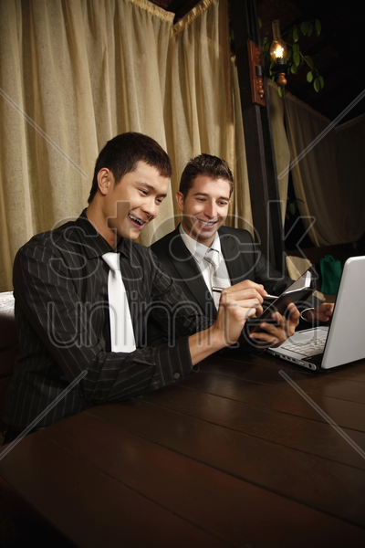 businessmen working together in a restaurant stock photo