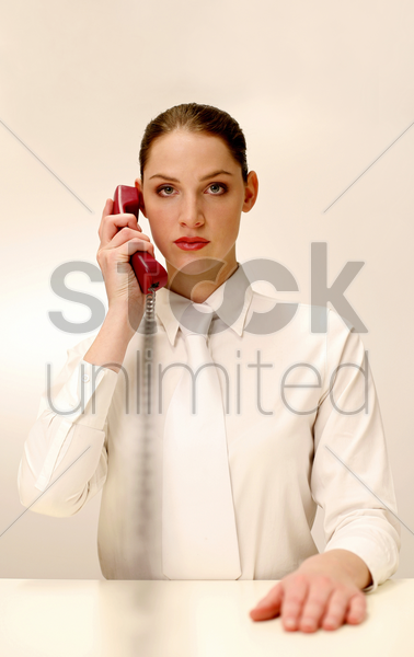 businesswoman answering a phone call stock photo