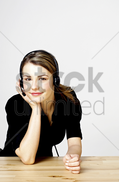 businesswoman answering calls stock photo