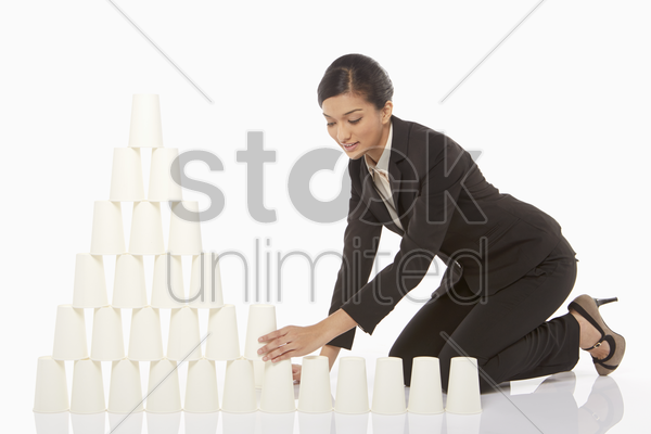 businesswoman arranging the disposable cups stock photo