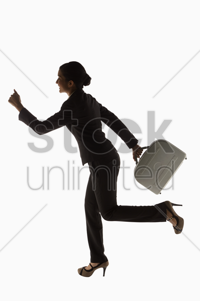 businesswoman carrying a briefcase, running stock photo
