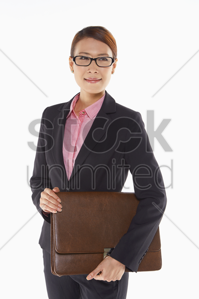 businesswoman carrying a briefcase stock photo