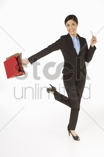 businesswoman carrying shopping bags and a credit card stock photo