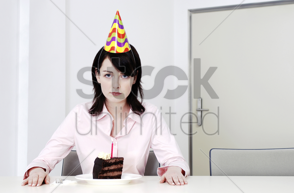 businesswoman celebrating birthday alone stock photo