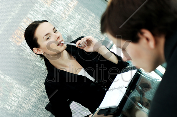 businesswoman checking out her colleague stock photo