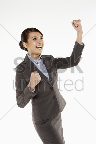 businesswoman cheering with fists in the air stock photo