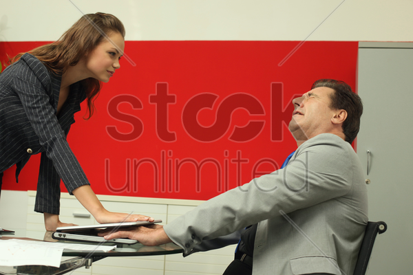 businesswoman closing laptop on businessman's hand stock photo