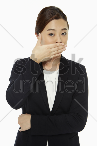 businesswoman covering her mouth stock photo