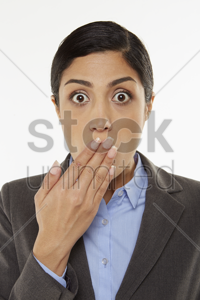 businesswoman covering mouth with hand stock photo