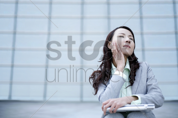 businesswoman daydreaming stock photo