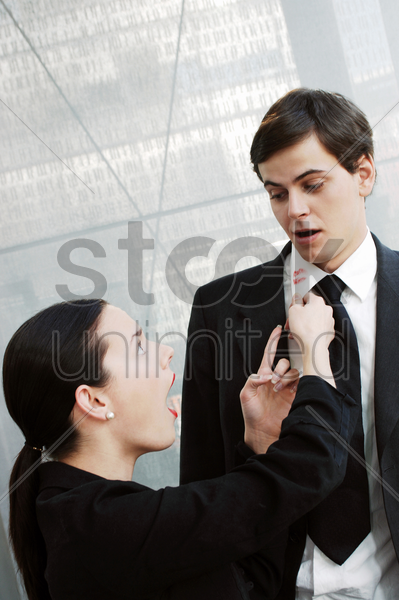 businesswoman discovering a lipstick stain on her boyfriend's collar stock photo