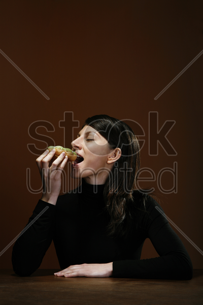businesswoman eating stock photo