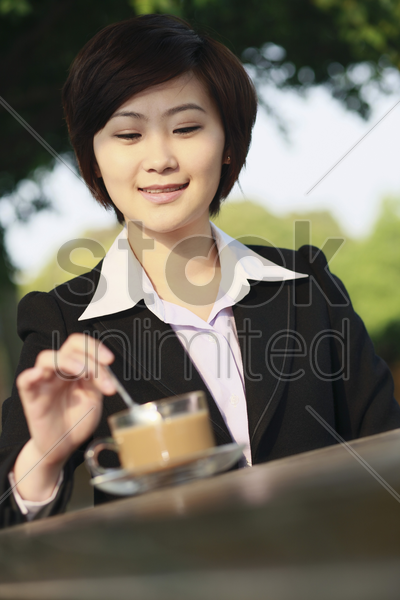 businesswoman enjoying coffee at an outdoor cafe stock photo