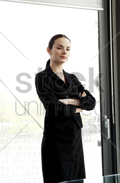 businesswoman folding her arms stock photo