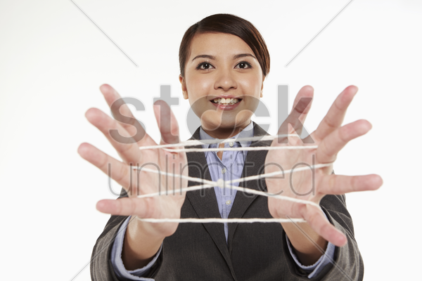 businesswoman forming a cat's cradle stock photo