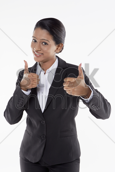 businesswoman giving two thumbs up stock photo
