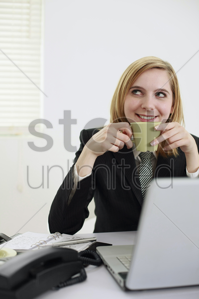 businesswoman having a cup of coffee stock photo