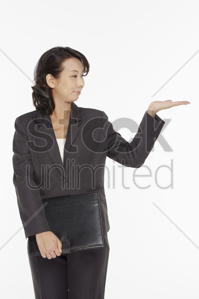 businesswoman holding a folder stock photo