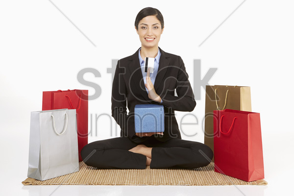 businesswoman holding a gift box and a credit card stock photo