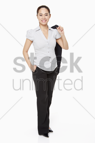 businesswoman holding a jacket and smiling stock photo