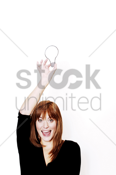 businesswoman holding a light bulb stock photo