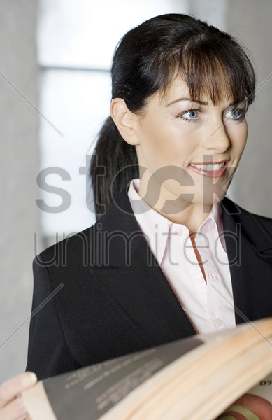 businesswoman holding a newspaper stock photo