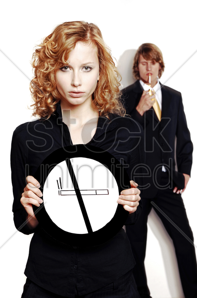 businesswoman holding a no smoking sign stock photo