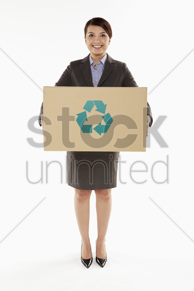 businesswoman holding a recyclable cardboard box stock photo