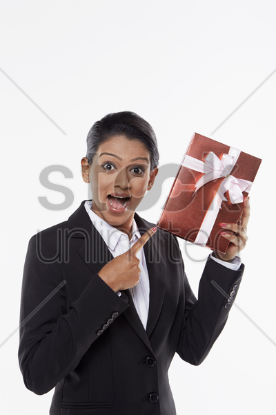 businesswoman holding a red gift box stock photo