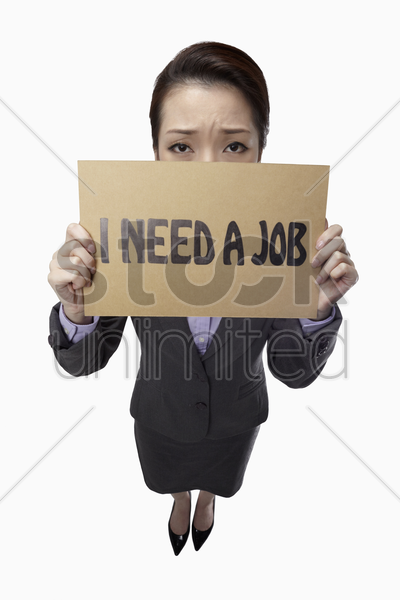 businesswoman holding  i need a job  sign stock photo