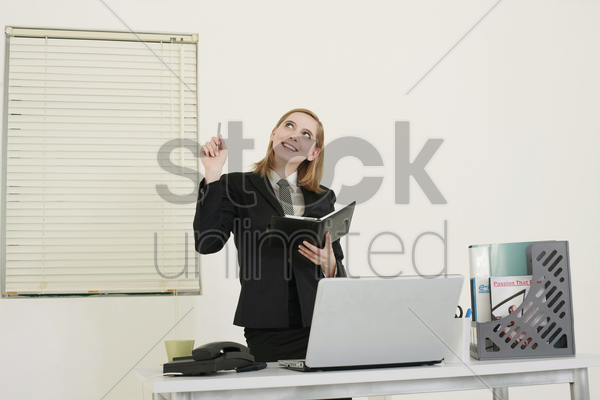 businesswoman holding organizer smiling stock photo