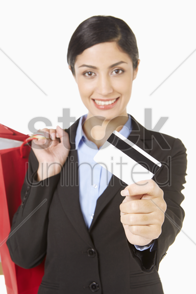 businesswoman holding shopping bags and a credit card stock photo