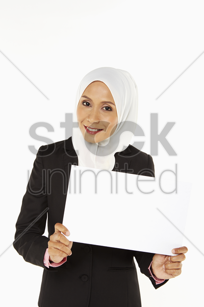 businesswoman holding up a blank placard stock photo