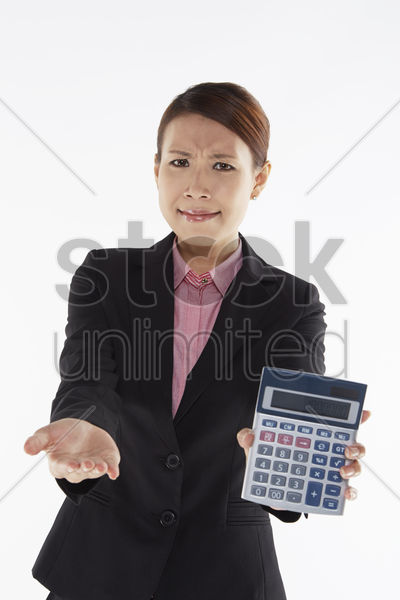 businesswoman holding up a calculator stock photo