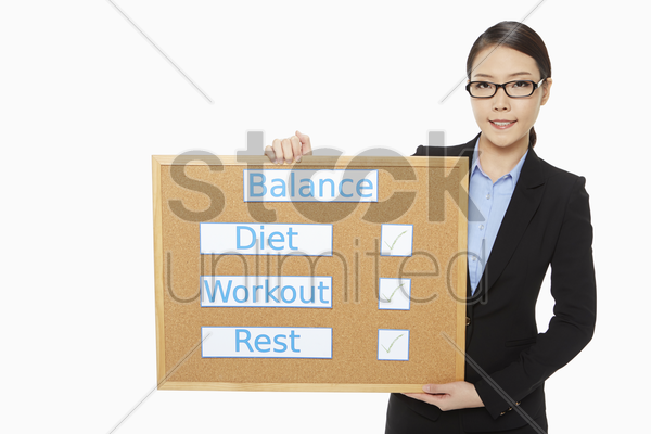 businesswoman holding up a notice board stock photo