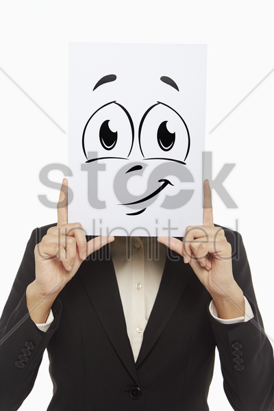 businesswoman holding up a smiley face doodle stock photo